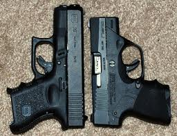 Glock 26 right, Beretta Nano left